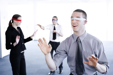 Blindfolded business people finding their ways