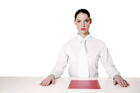Businesswoman with a document in front of her Stock Photo