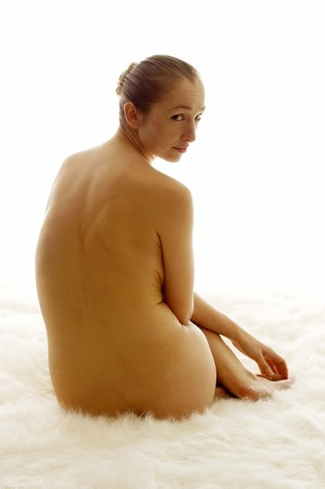 Back shot of a nude woman photo