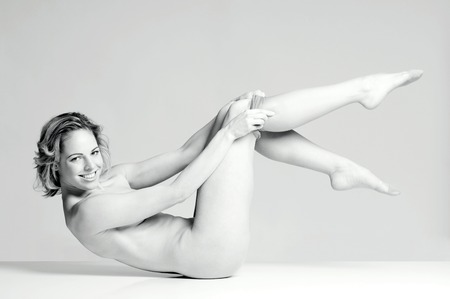 Nude woman wearing pantyhose photo