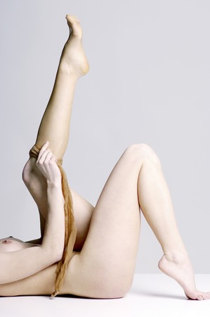 Side shot of Nude woman wearing pantyhose photo