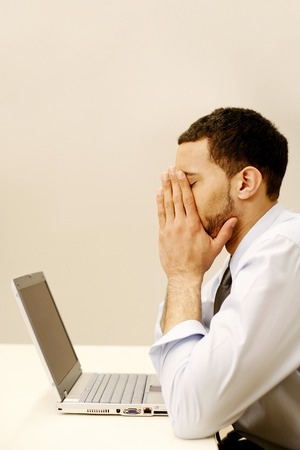 eyes closing: An overworked businessman Stock Photo