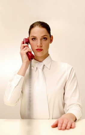 Businesswoman answering a phone call photo
