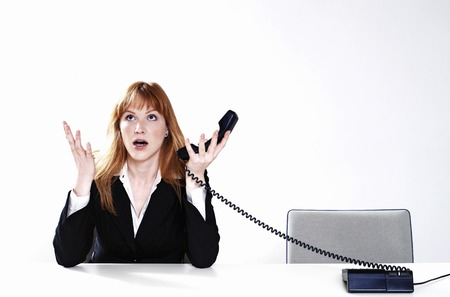 Businesswoman getting frustrated with her customer Stock Photo