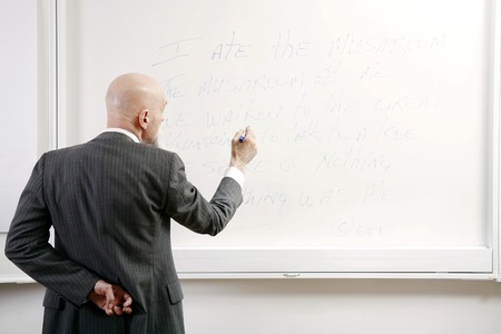he old: Professor writing on the white board Stock Photo