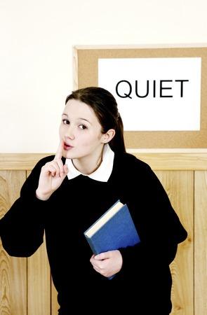 hushing: School girl showing a hushing sign