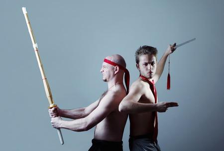 sword act: Two men practicing martial art