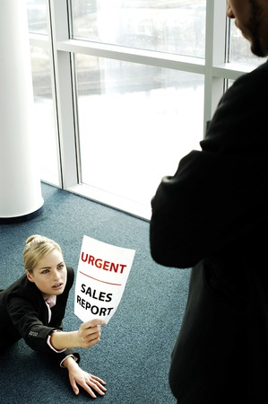 Businesswoman submitting an urgent sales report photo