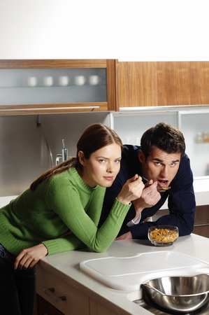 Couple sharing a bowl of breakfast cereal photo