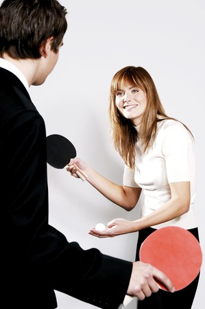 desirous: Businessman and businesswoman playing table tennis Stock Photo