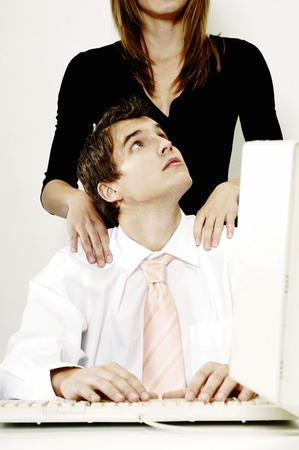 desirous: Businesswoman giving her colleague a shoulder massage