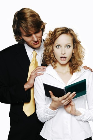 Businessman touching his female colleague photo
