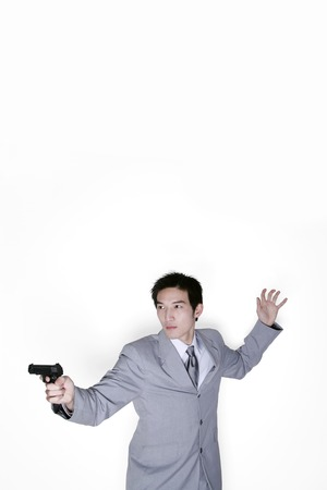 Businessman aiming his pistol photo