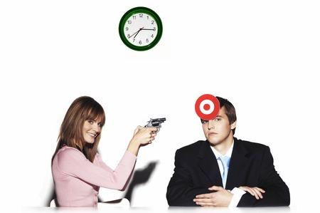 subordinate: Businesswoman holding a pistol targeting at her subordinate