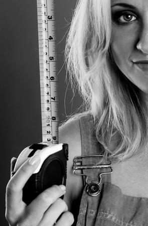 measurement tape: Woman holding measurement tape