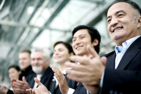 Corporate people clapping hands photo