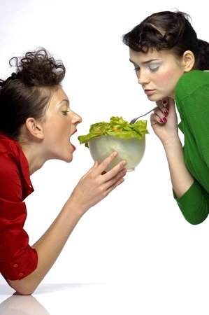 eating right: Two women eating salad