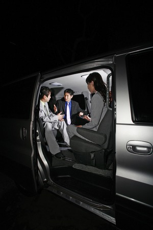 Corporate people having discussion in the car photo