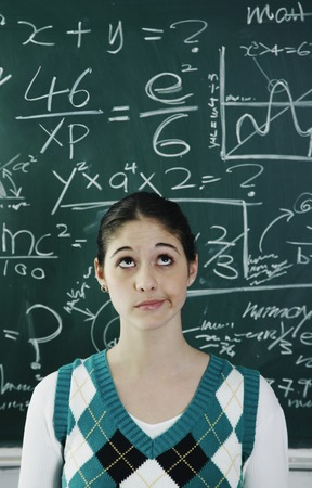 Girl having problems solving the confusing equation photo