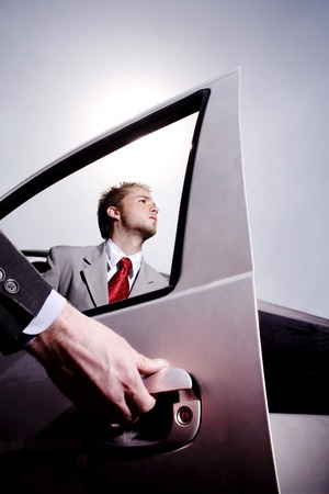 opening door: Hand opening car door for a businessman