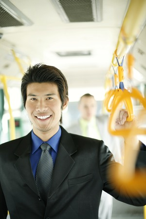 desirous: Businessman standing in the train