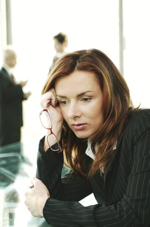 deep in thought: Businesswoman in deep thought