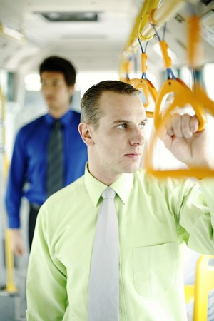 desirous: Corporate people standing in the train Stock Photo