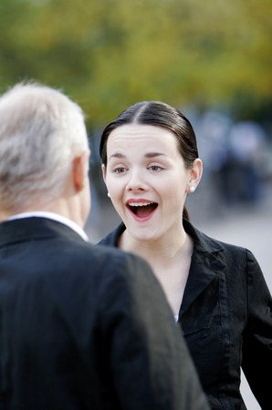 desirous: Businesswoman happy to see her client Stock Photo