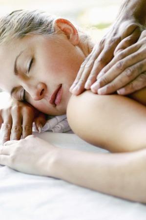 spoiling: Woman enjoying a body massage Stock Photo
