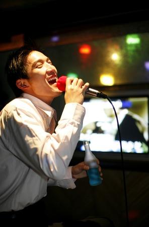 Man singing in a karaoke lounge photo