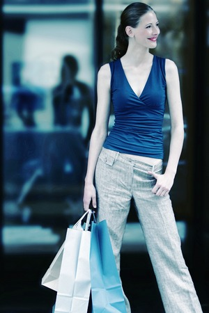 Woman carrying paper bags photo