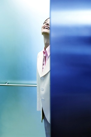 looking up: Businesswoman looking up