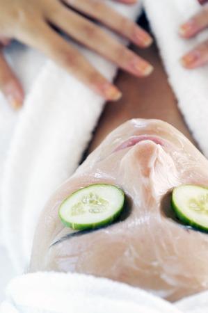 facial treatment: Woman doing facial treatment Stock Photo
