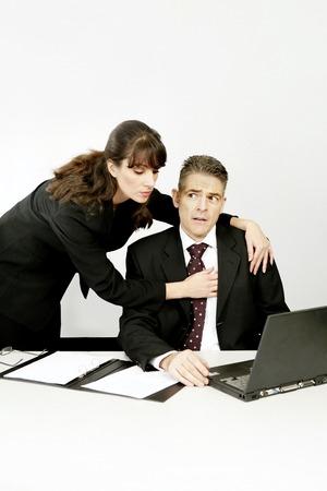 Businesswoman seducing her superior Stock Photo