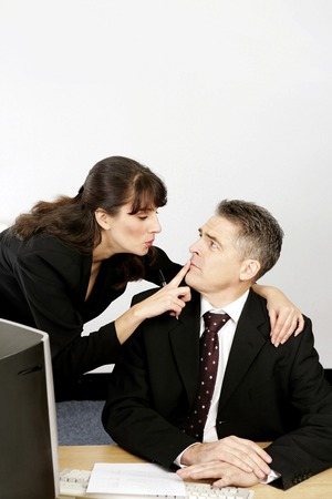 Businesswoman asking her superior to keep secret