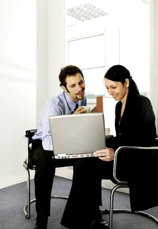 Businessman and businesswoman working together photo