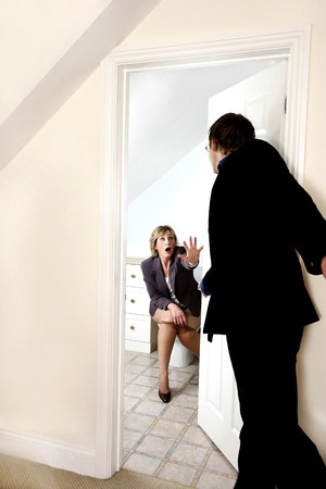 awkward: Businesswoman getting a surprise visit while sitting in the toilet