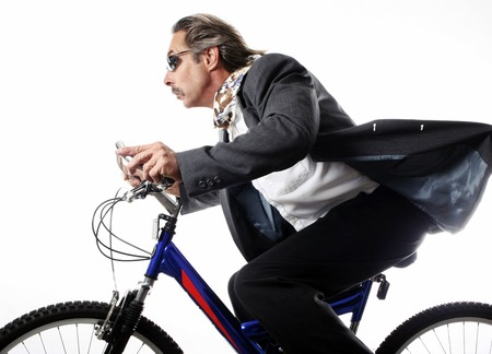 Businessman cycling photo