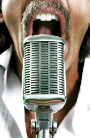 Man screaming into a microphone
