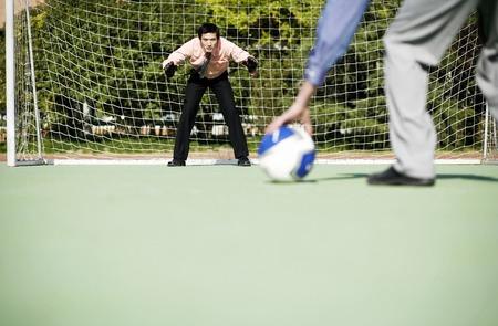 Businessmen playing football photo