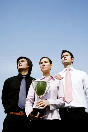 Corporate people with their trophy photo