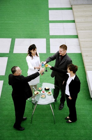 proposing a toast: Business people celebrating their achievement