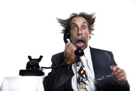 shocking: Businessman receiving a shocking phone call