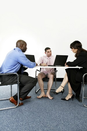 Businessman in boxer shorts having discussion with his business partners photo