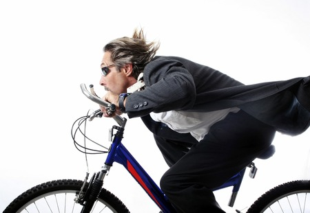 Businessman cycling at a fast speed