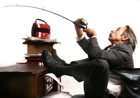 Businessman fishing at his table