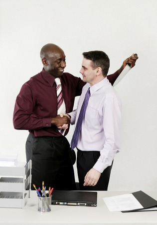 stabbing: Businessman stabbing his colleague with a knife while shaking his hand Stock Photo