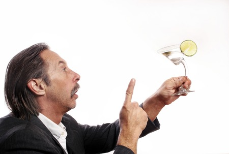 Drunk businessman talking to a glass of alcoholic drink photo