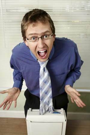 shredder machine: Businessman in shock after looking at his shredded tie