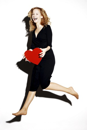 Businesswoman holding a red heart photo